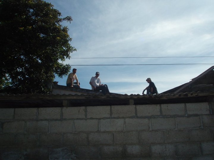 Adam Tom and Bob on the roof